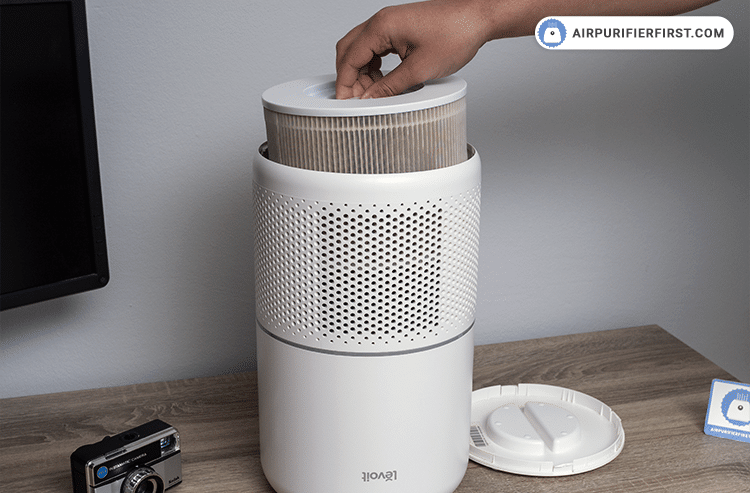 Unplug air purifier. Remove filter cover and take out the old filter.