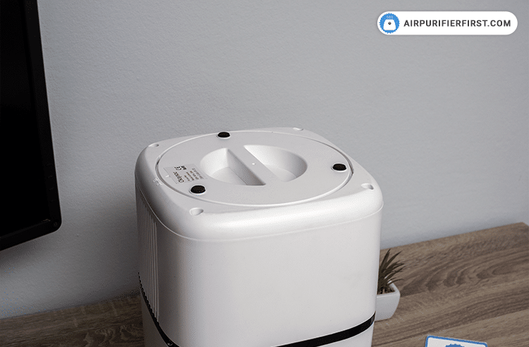 Place back the bottom cover of the air purifier
