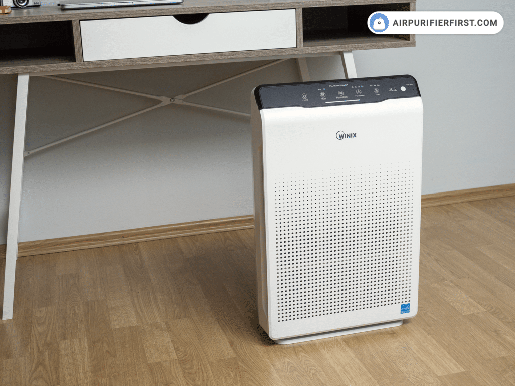 Winix C535 Air Purifier In Front Of The Desk