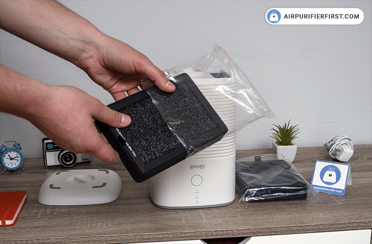 Prepare a new filter and place it inside the air purifier.