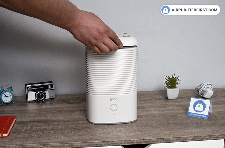 Seal the filter cover, place the air purifier in the desired location, and plug it in an outlet.
