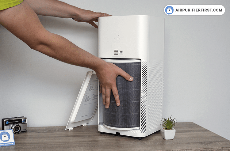 Prepare a new filter, take it out of the package and insert it into the air purifier