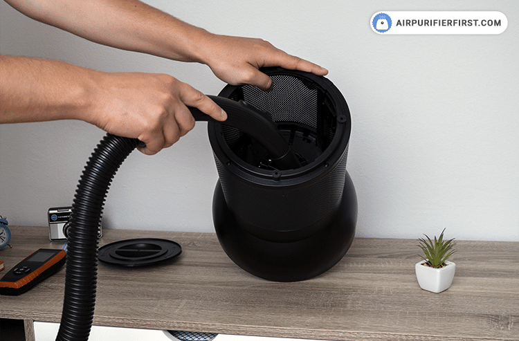 The next step is to vacuum the inside of the appliance with a vacuum cleaner to remove excess dust particles.
