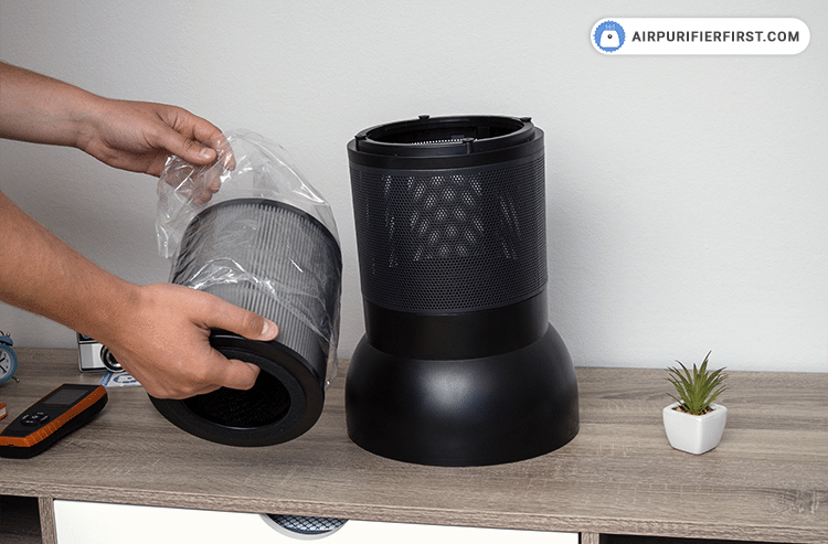 Prepare the new filter, unpack it, then insert it into the appliance and close the lid.