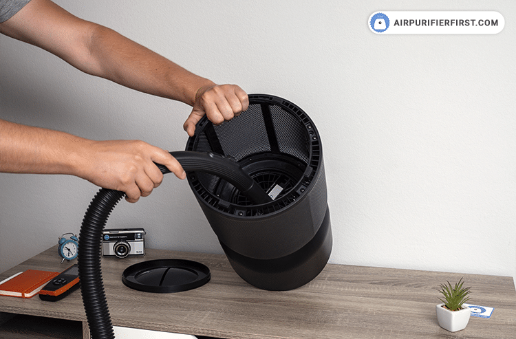 The next step is to vacuum the inside of the air purifier with a vacuum cleaner to remove excess dust particles.