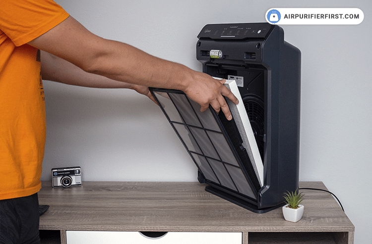 Remove the pre-filter by pressing the tabs near the top, and after that, pull out the old AOC Carbon and True HEPA filters.