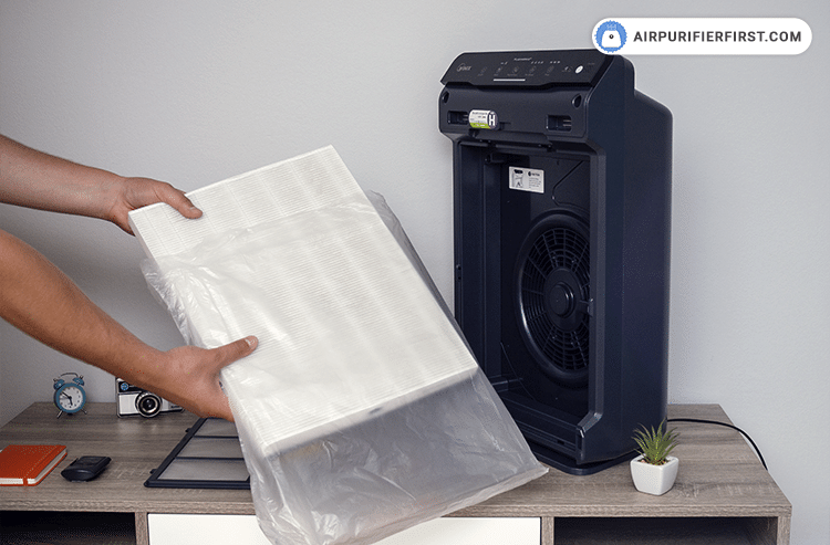 The last step is to remove the new filters from the protective plastic wrap and then insert it into the device. The True HEPA filter goes first, and after it is the AOC Carbon filter.